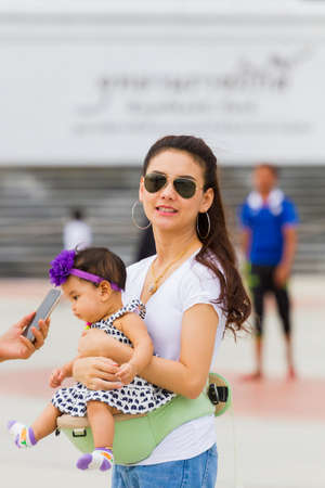 PRACHUAP KHIRI KHAN, THAILAND - AUGUST 26 : unidentified beautiful asian mother taking photo with her baby at Rajabhakti Park on August 26, 2017 in Prachuap Khiri Khan, Thailand