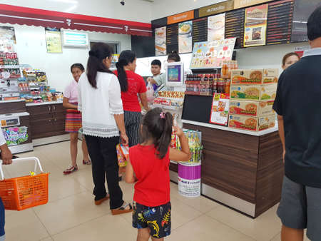 7 8: CHIANG RAI, THAILAND - MAY 8 : Unidentified people standing at the cashier counter at a 7-Eleven shop on May 8, 2017 in Chiang rai, Thailand. Editorial