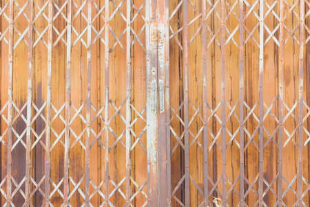 Old rusty steel vintage shutter door texture pattern and background, Thailand