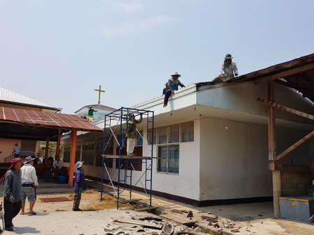 CHIANG RAI, THAILAND - MARCH 29 : unidentified workers repairing or changing roof of Thai protestant church on March 29, 2017 in Chiang rai, Thailand.