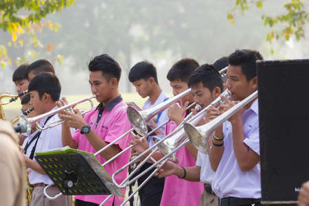 NAKHON SAWAN, THAILAND - FEBRUARY 17: Unidentified asian students playing jazz music at walking street on February 17, 2018 in Nakhon sawan, Thailand