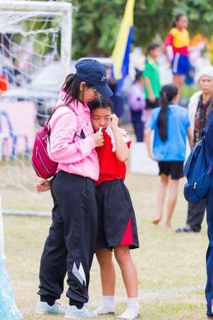 CHIANGRAI, THAILAND - DECEMBER 29: unidentified mother using herbal inhaler for her daughter after running race competition on December 29, 2017 in Chiangrai, Thailand.