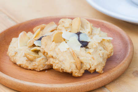 extreme close up cashew cookies on wooden dish with blurred background