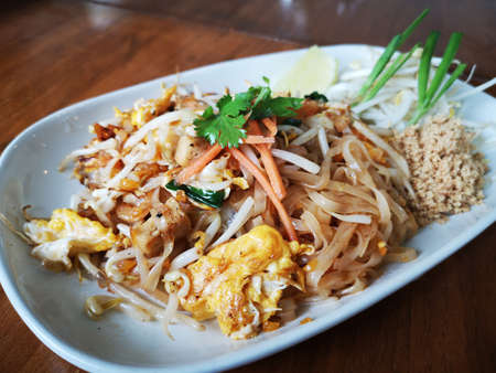 fried noodles with omelette mixed together. Thai food Stock Photo