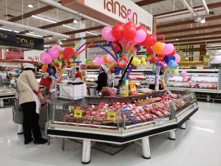 CHIANG RAI, THAILAND - FEBRUARY 15 : sausage shop with female worker and colorful balloon in supermarket  on February 15, 2019 in Chiang rai, Thailand. Editorial