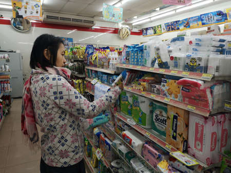 CHIANG RAI, THAILAND - JANUARY 10 : unidentified woman choosing toilet papers in 7-eleven store on January 10, 2019 in Chiang rai, Thailand.