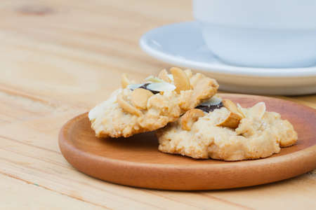 Cashew cookies on wooden desktop with copy space Stock Photo