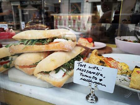sandwich on a counter show window in Portobello Market, Notting Hill.