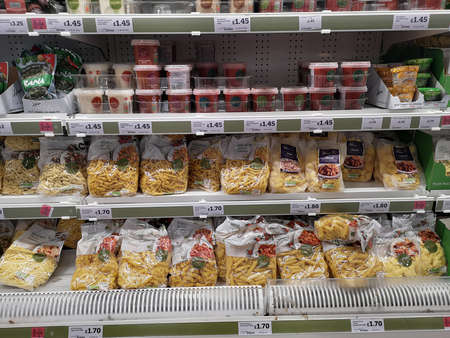 LONDON, UK - OCTOBER 7 : various kinds of cheese in refrigerator sold in supermarket on October 7, 2019 in London, UK.