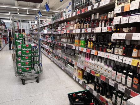 LONDON, UK - OCTOBER 7 : perspective view of shelves with alcoholic drinks in the supermarket on October 7, 2019 in London, UK. Editorial