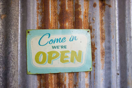 Vintage open sign on rustic galvanized iron 写真素材
