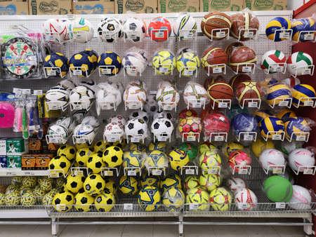 CHIANG RAI, THAILAND - NOVEMBER 20 : balls or sport equipment sold on supermarket stand or shelf on November 20, 2019 in Chiang Rai, Thailand. Editorial