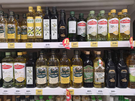 CHIANG RAI, THAILAND - NOVEMBER 21 : various brand of olive oil sold on supermarket display shelf on November 21, 2019 in Chiang Rai, Thailand.