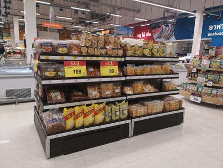 CHIANG RAI, THAILAND - NOVEMBER 21 : various brand of Thai traditional snacks sold on supermarket display shelf on November 21, 2019 in Chiang Rai, Thailand. Editorial