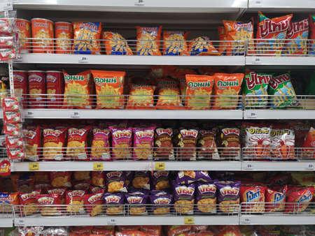 CHIANG RAI, THAILAND - NOVEMBER 21 : various brand of Thai snacks sold on supermarket display shelf on November 21, 2019 in Chiang Rai, Thailand.