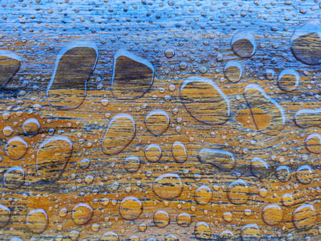 close-up water drops on a wooden surface