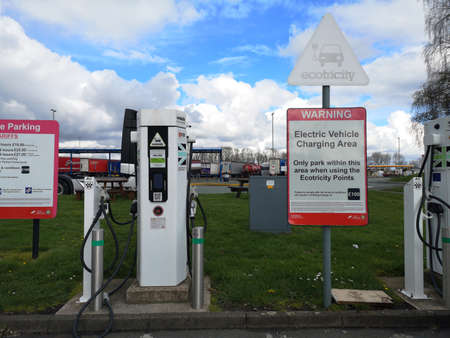 Liverpool, England - APRIL 2 : electric vehicle charging station at service with instructions sign on April 2, 2019 in Liverpool, England.