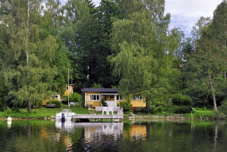 Summer house with boat  photo