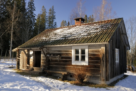 Traditional log cabin in a holiday resort in Dalarna, Sweden