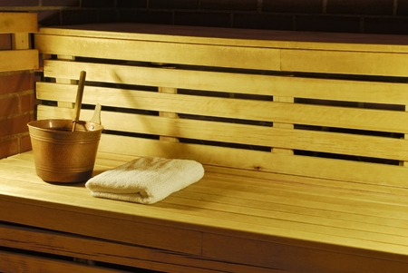 the occupant: Sauna with towels, bucket and ladle and tropical flower just waiting for occupant