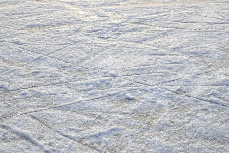 ice rink: Skate marks on the surface of an outdoor ice rink