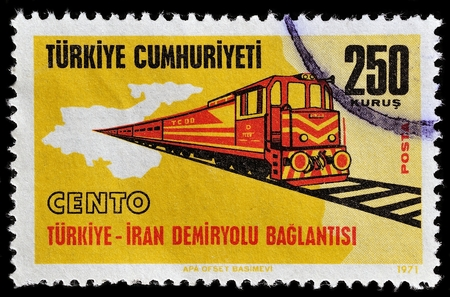 philatelic: TURKEY - CIRCA 1971: A stamp printed commemorates regional cooperation between Turkey and Iran on building a railroad link, circa 1971
