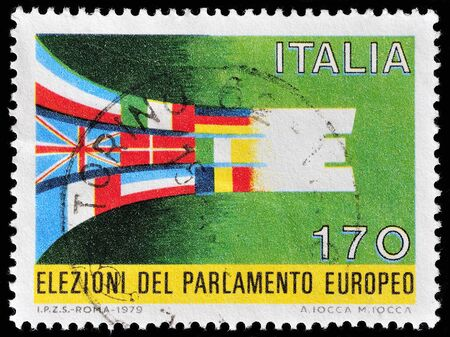 philatelic: ITALY - CIRCA 1979: a stamp printed in Italy celebrates the first elections to European parliament showing flags of UE member states. Italy, circa 1979