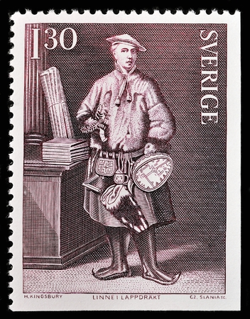 botanist: SWEDEN - CIRCA 1978: A stamp printed by SWEDEN shows Swedish botanist, physician, and zoologist Carl Linnaeus (Carl von Linne) in the traditional dress of the Sami people of Lapland, circa 1978 Editorial