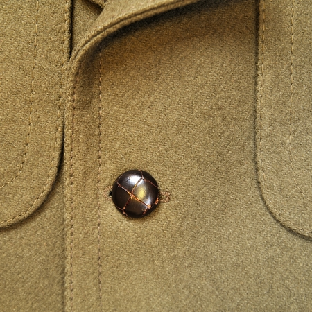 dry cleaned: Close-up of a classic blue wool suit with button