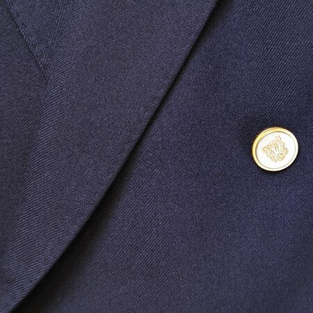 dry suit: Close-up of a classic blue wool suit with button