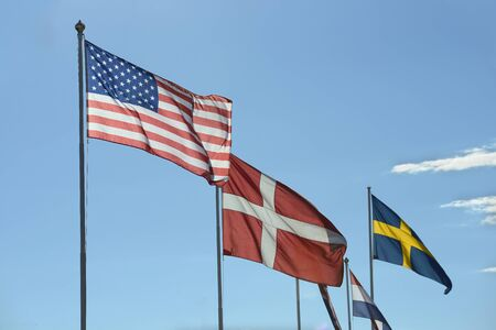 backlit: Flags, backlit on a clear sky.