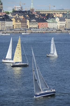 race for time: Stockholm, Sweden - June 28, 2015: Round Gotland F Offshore Race is a classic off shore race with a history of 70 years. For the first time this year the start was in Stockholm. Many different classes are com peating and the race will in normal weather ta