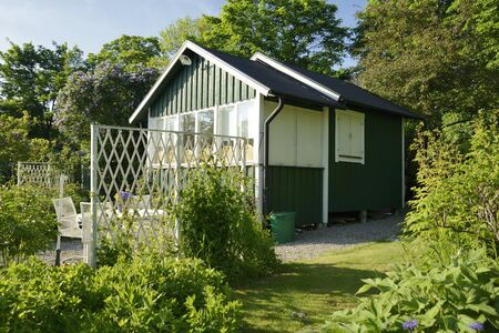 idyllic: Idyllic green cottage in botanical garden Stock Photo