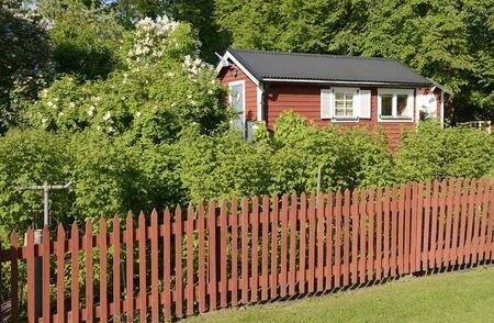 no entrance: Idyllic red cottage in botanical garden