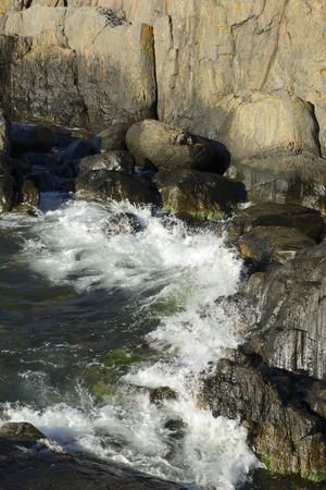 waves crashing: Waves Crashing on Rocks.