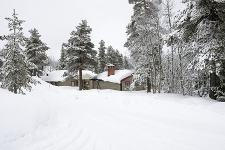 winter finland: A cabin in the forest covered in snow, Salen in Sweden.