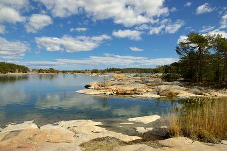 Stendorren in the Swedish archipelago. Calm water with clouds. Standard-Bild