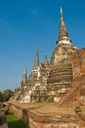 Stupas (chedis) of a Wat in Ayutthaya, Thailand. Ayutthaya city is the capital of Ayutthaya province in Thailand.  photo