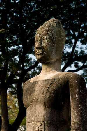 Buddha staue resting under a tree in Aytthaya. Ayutthaya city is the capital of Ayutthaya province in Thailand. Its historical park is a UNESCO world heritage. photo