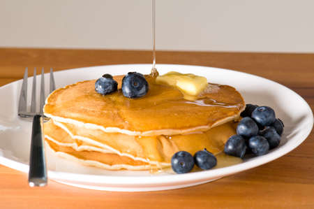 blueberry pancakes on a plate with fork on a wooden table Stock Photo - 7716636