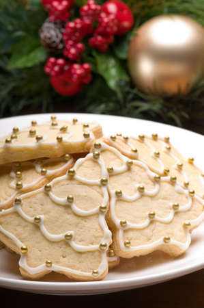 Decorated christmas cookies in festive setting with tree decoration photo