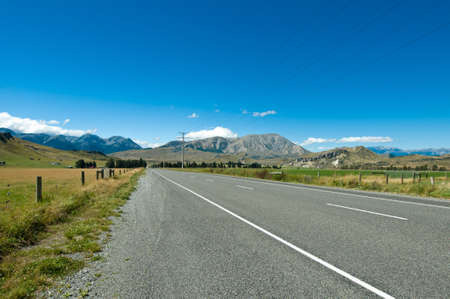 Highway towards panoramic mountain on a summer day Stock Photo - 8810678