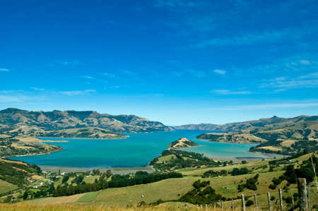 south island new zealand: Beautiful summer day view into the Akaroa Harbour, New Zealand