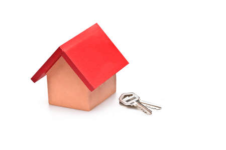 roofed house: red roofed house over white with house keys