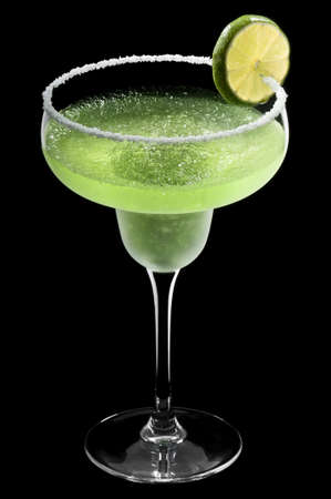 Green Margarita in front of a black background with fresh garnish photo