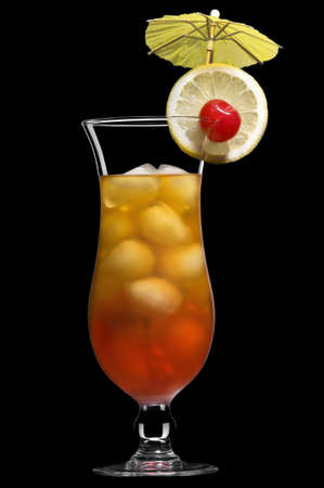 Tequila sunrise over black in a beautiful long drink glass photo