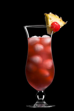 Singapore sling over black in a beautiful long drink glass Stock Photo - 9893945