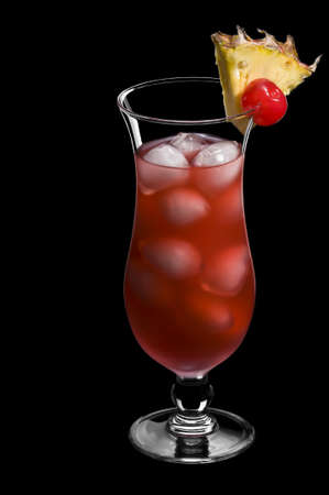Singapore sling over black in a beautiful long drink glass Stock Photo - 9893950