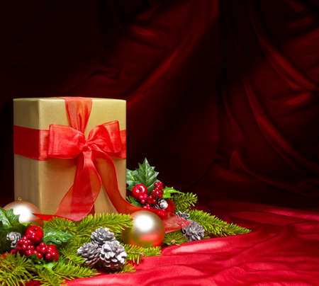 Present decorated with red satin and Christmas decoration, with space for advertising text Stock Photo - 10056586