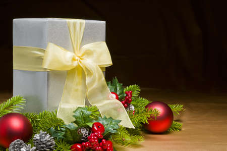 Present decorated with gold satin and Christmas decoration, with space for advertising text photo